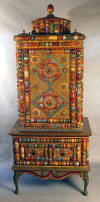 tall cabinet fine furniture wisconsin artist furniture maker  interior design interior designer home furnishings home decor faux finish tramp art folk art  art outsider art painted furniture rustic country fine furniture art furniture studio furniture hand made